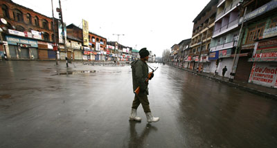 A paramilitary CRPF trooper stands guard at deserted Lal Chowk (Red Square) in Srinagar, Monday. Kashmir valley observed a complete shut down and marked the 60th Indian Republic Day as a black day. Farooq Javed/ Rising Kashmir