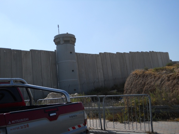 The apartheid wall with watch tower - photo taken during a visit in September