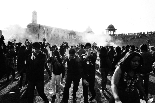I took this photograph just after being dragged by my collar by a policeman. I too would have been beaten up if it was not for the camera in my hand. He was furious because I protested against him hitting a young woman standing peacefully next to me. As you can see we have covered our faces and are running away from the tear gas shells. Our eyes were burning and throats hurting. We dispersed but within a few minutes gathered back. This happened quite a few times today. Many young men and women got injured. But we did not give up, we kept coming back. With each lathicharge we became stronger and less scared. All this while we thought we were fighting for you. But today we realized we are fighting for ourselves.