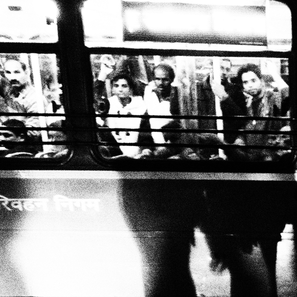 Passengers in a DTC bus try and catch a glimpse of the candle light vigil organised outside Safdarjung Hospital. Thousands of commuters became witness to today's meet – some got down from their buses to join the vigil. Some joined their hands when their gaze fell on the bed of candles. An old woman took out her hair clip that was shaped like a flower and threw it towards us.