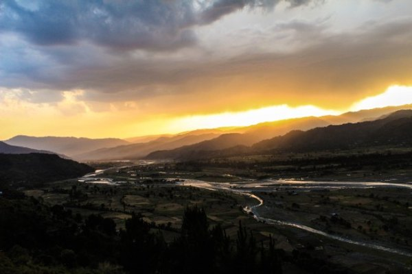 The poet took this photograph in Poonch by the river Suran last summer.Across the second ridge lies the Line of Control. Taken from the Indian side, the photo captures the sun setting on the Pakistani side.
