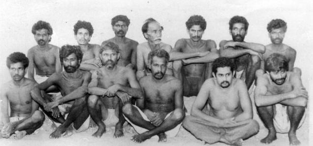 [This June 19, 1993 photo shows Veerapan aides Simon (front row, second from left) and Madaiah (fourth from left) among other landmine blast accused. Courtesy The Hindu/PTI.]