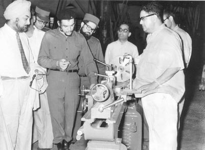 Che Guevara being shown a Lathe Manufacturing Machine at the Okhla Industrial Estate in New Delhi. July 1, 1959.