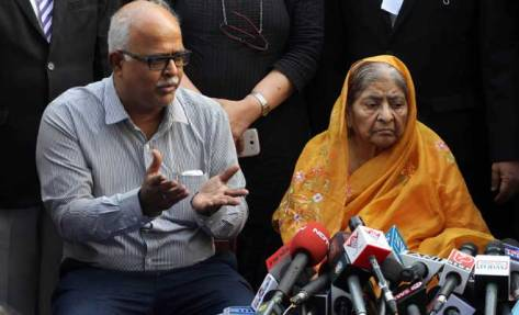 Zakia Jafri listens to her son Tanveer Jafri after a court ruling rejecting a petition seeking the prosecution of BJP leader Narendra Modi. (PTI Photo)