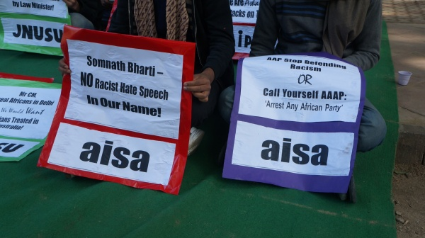 SIGNS AT ANTI RACISM PROTEST IN JANTAR MANTAR