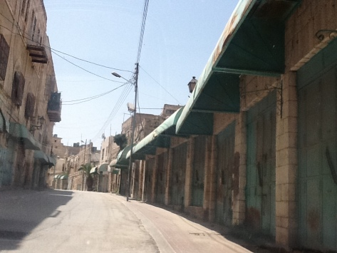The old market area near Shuhada that has remained closed since mid 1990s. Once the restrictions on movement were put in place, it became impossible for Palestinian shopkeepers and customers to access the area. Some shops were vacated due to direct military orders, others because they could no longer be accessed by the owners.