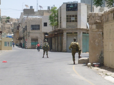 Empty Streets Patrolled by Israeli Soldiers