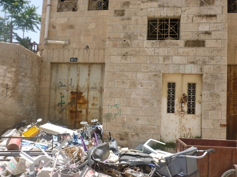 Garbage Piled High Next to Remaining Palestinian Homes