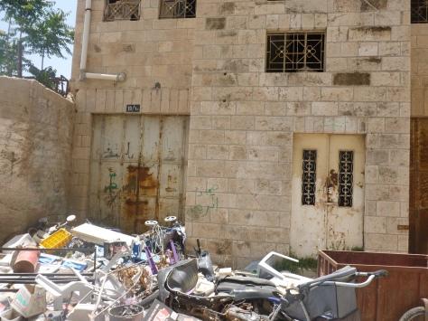 Garbage Piled High Next to Remaining Palestinian Homes