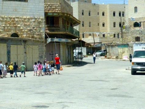 Children of Settlers being Escorted to Kindergarten through Empty Streets