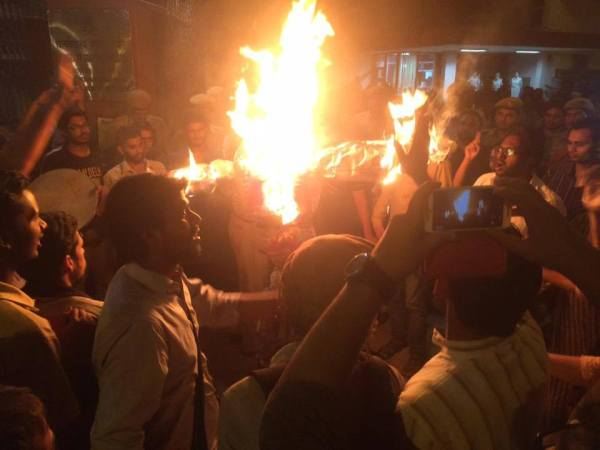 Burning Effigies at Night - Fighting to Save Education