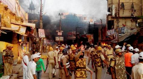 Mainpuri: Police in action after villagers vandalised properties and resorted to arson in Mainpuri district on Friday over rumours of cow slaughter in the area. PTI Photo (PTI10_9_2015_000290B)