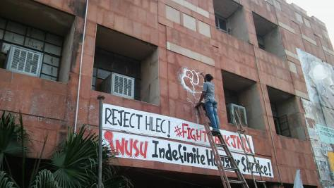 Students from Jamia Millia Islamia University painting signs and graffiti in support of the JNU students on Hunger Strike